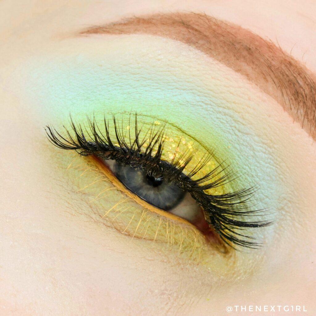 Geel met blauw groene ooglook met glitters CP